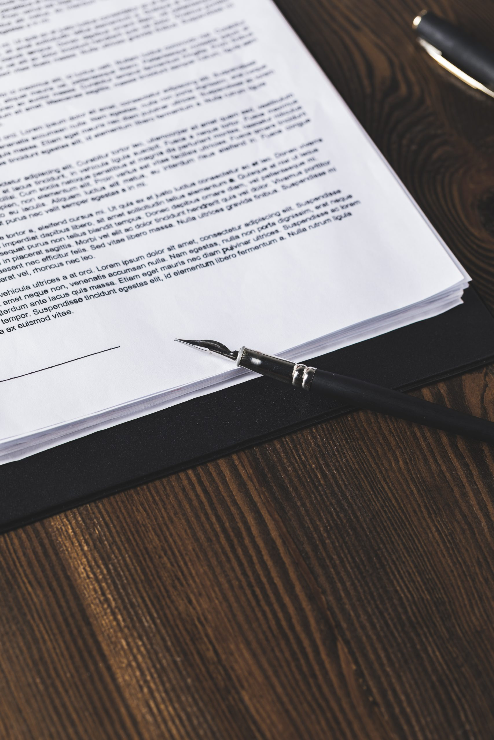 juridical contract on wooden table with pen, law concept